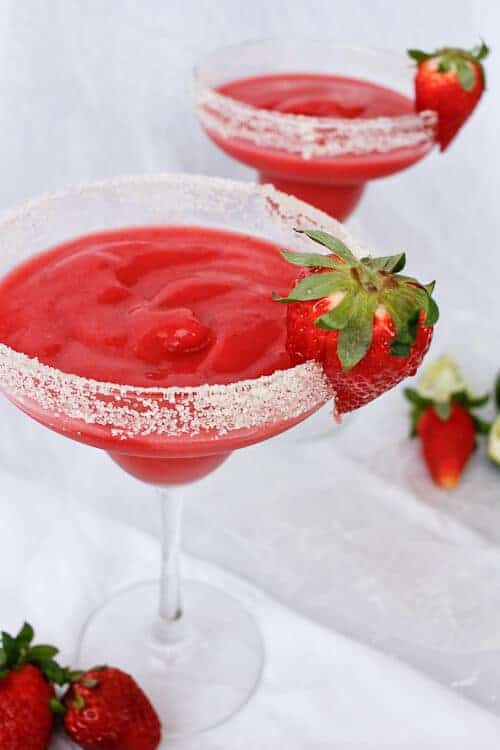 These Frozen Strawberry Rhubarb Margaritas use rhubarb simple syrup and frozen strawberries for a cold and delicious spring cocktail!