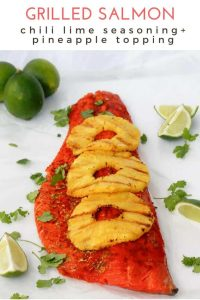 This grilled salmon recipe is perfect for summer cookouts + bbqs. Prep the salmon with a sweet chili powder and lime rub, and serve with grilled pineapple.