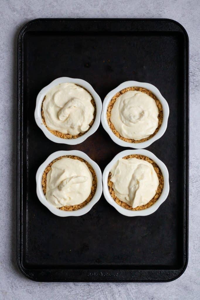 Scoop Cheesecake Filling Into Ramekins