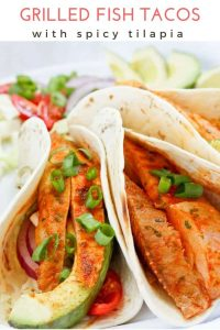 These easy grilled fish tacos feature spicy tilapia, a quick cabbage slaw, and an easy yogurt sauce. Serve a crowd with an easy taco bar!