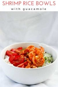 These easy + healthy Tex-Mex (Mexican style) shrimp rice bowls are made with spicy shrimp, veggies (tomatoes,), and a yogurt guacamole.