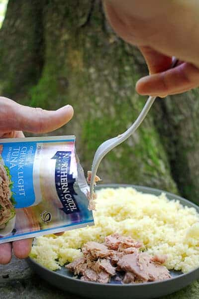 Adding Tuna from a Packet to the Couscous