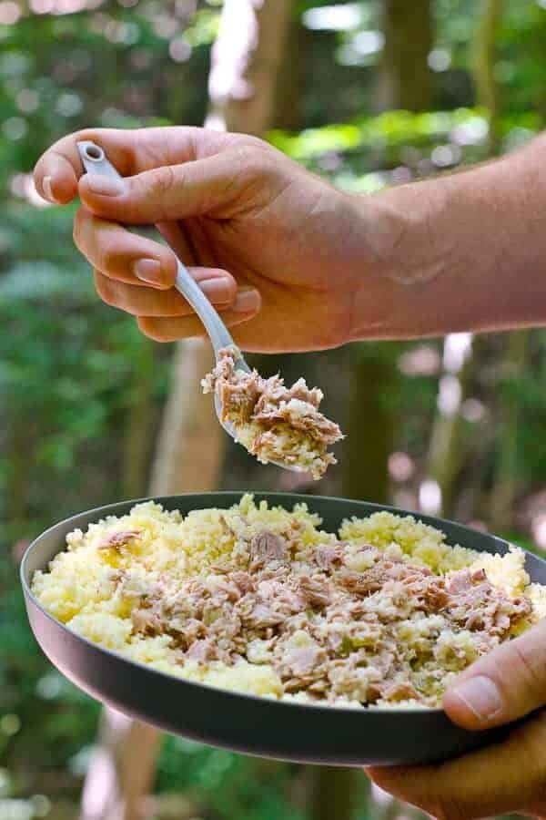 Eating a Backpacking Tuna Couscous Bowl in the Woods