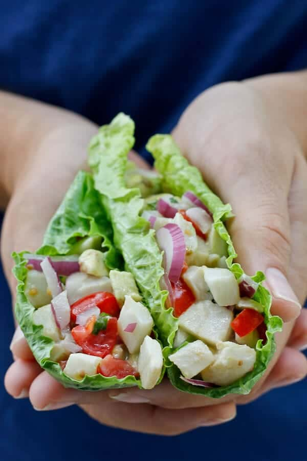Holding Grapefruit Flounder Ceviche in Lettuce Wraps