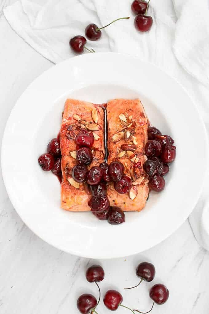 This Almond Cherry Seared Salmon is the perfect date night centerpiece, and features rich king salmon seared to perfection and topped with hot, juicy cherries and toasted almonds.