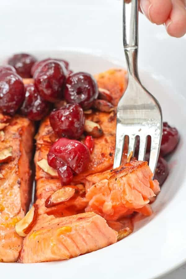 Flaking Apart Almond Cherry Seared Salmon in a Serving Dish