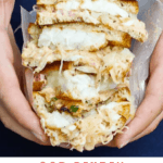 This Cod Reuben Sandwich is a fishy take on a classic deli-style Reuben! It's piled high with seared cod, sauerkraut, and a homemade yogurt-based Russian dressing.