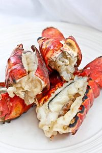 This grilling season, bring out the lobster! These incredibly easy Grilled Bourbon Lobster Tails are grilled to perfection and coated with a bourbon butter sauce.