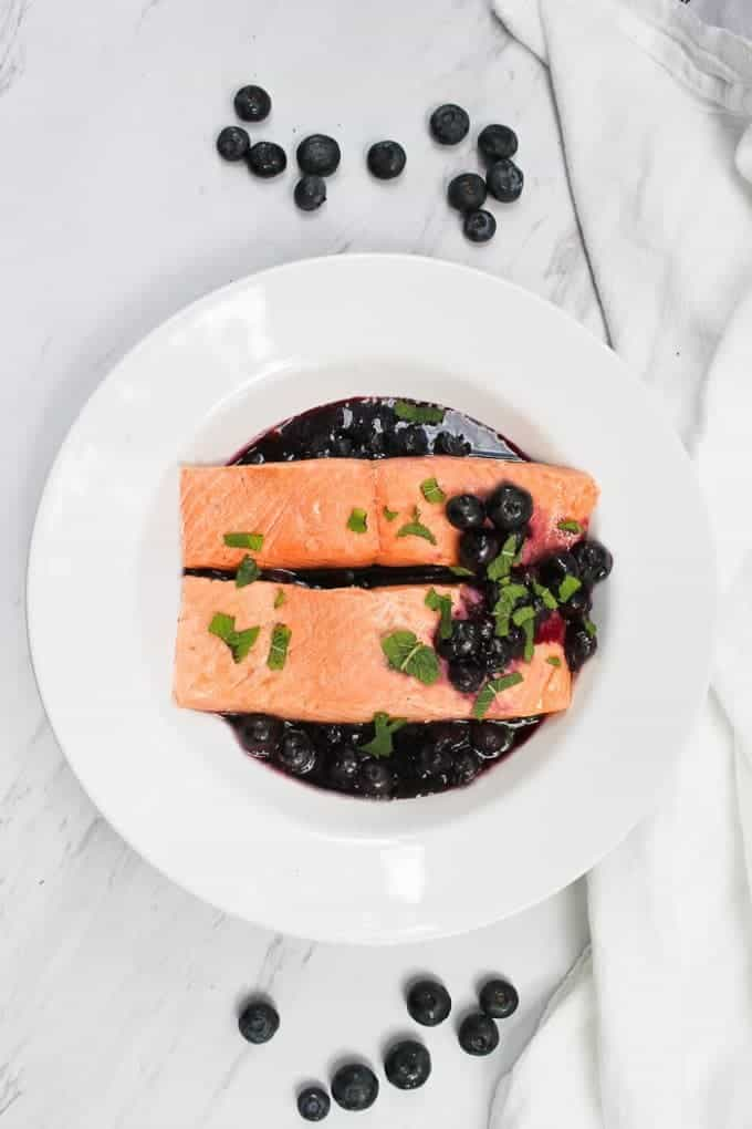 Poached Salmon with Blueberry Sauce in a Serving Dish