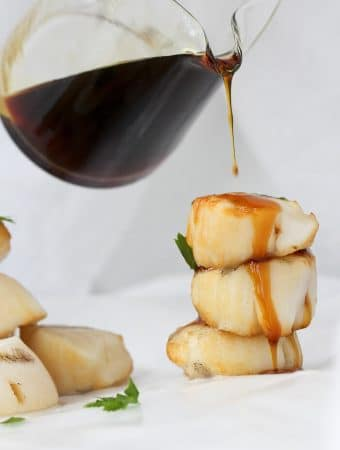 These Bourbon Grilled Scallops are cooked on skewers on the grill, and topped with an easy, sweet bourbon sauce!