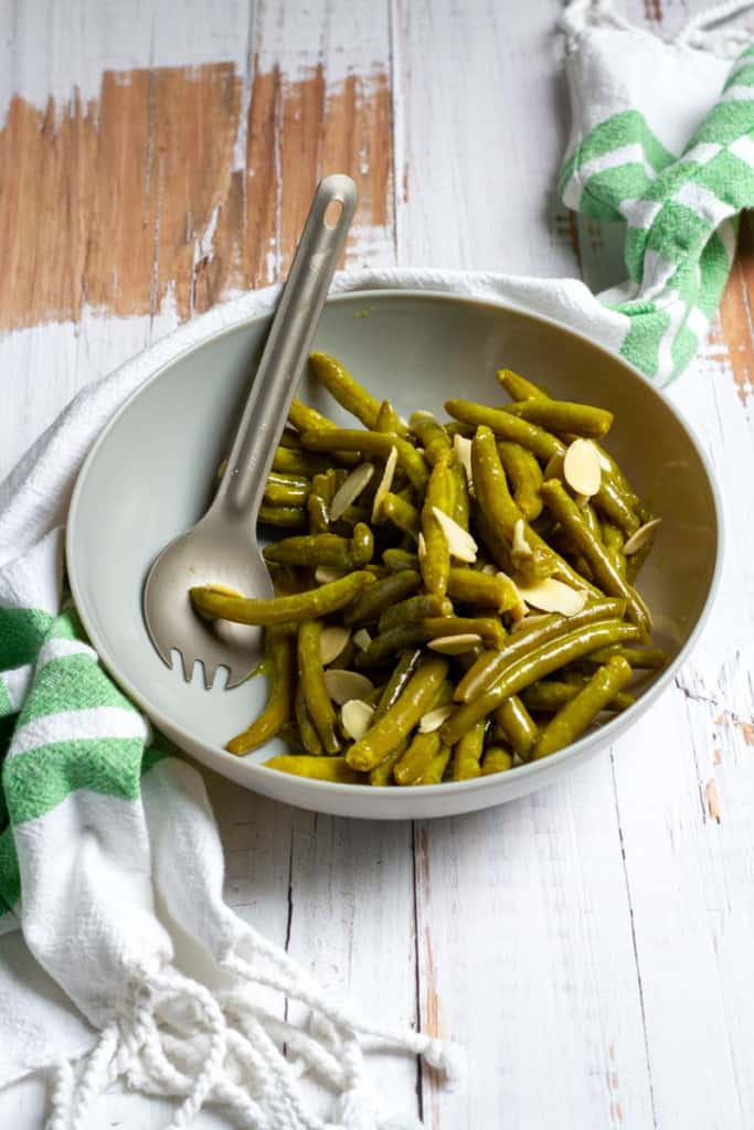 canned green bean salad in a serving bowl
