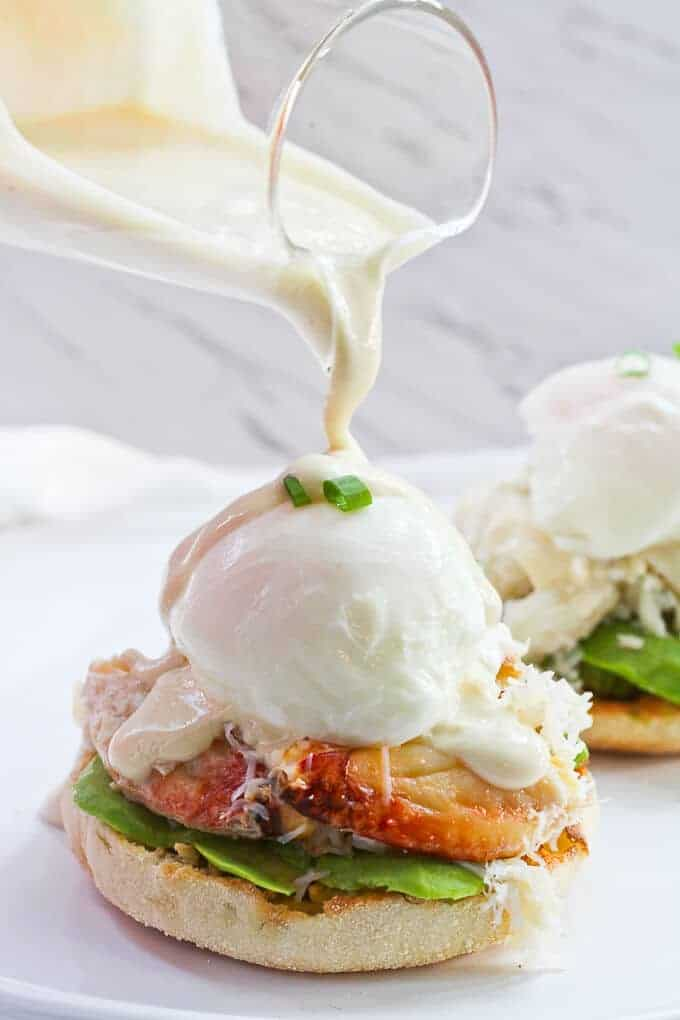 Pouring Yogurt Sauce onto Dungeness Crab Eggs Benedict