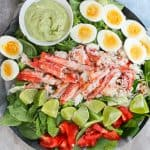 This Grilled King Crab Salad with Creamy Avocado is delicious at home or at a picnic, and is a light, refreshing, and healthy seafood salad!
