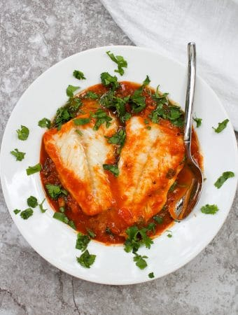 This easy Pumpkin Cod Curry is made with a spiced pumpkin and tomato sauce, fresh spinach, and gently poached cod.