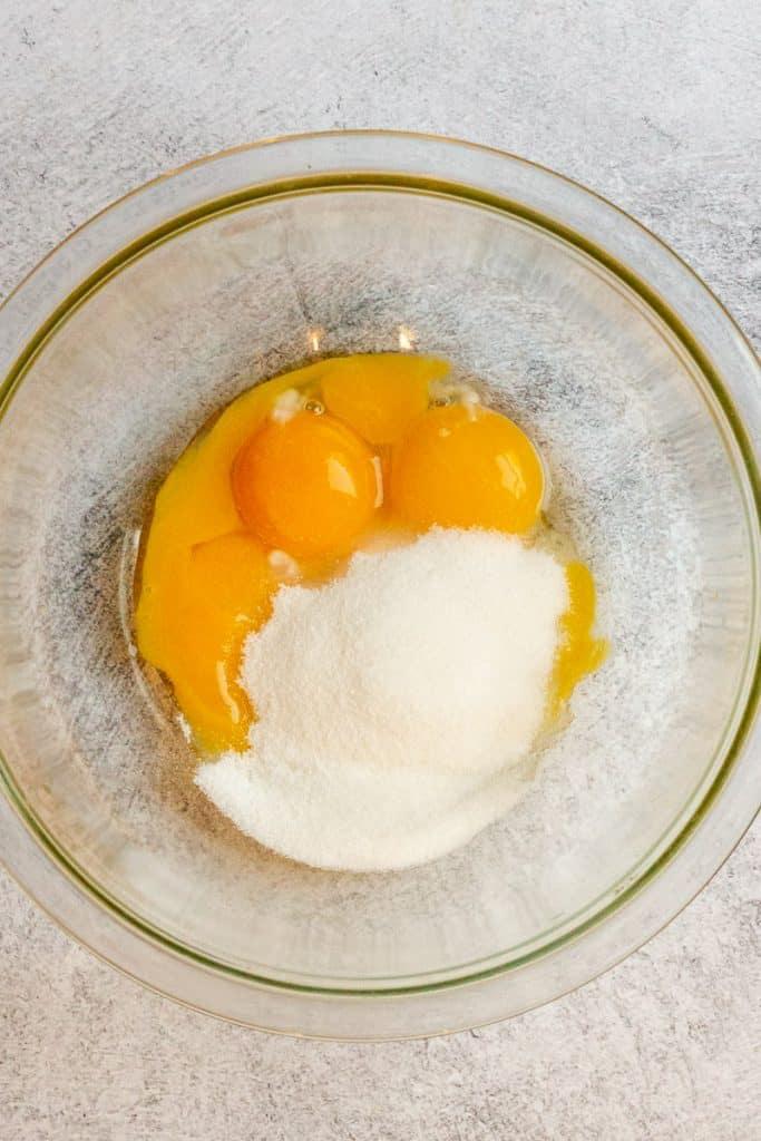 Add Eggs + Sugar to a Bowl