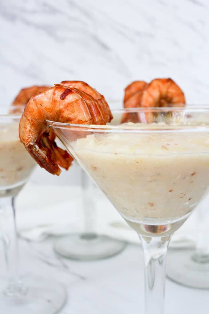 Cajun Shrimp and Grits Served in Cocktail Glasses with the Shrimp on the Glass Rim