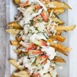 These Healthy Crab Fries are made with baked fries, and loaded with crab meat, a little cheese, and a garlic yogurt sauce.