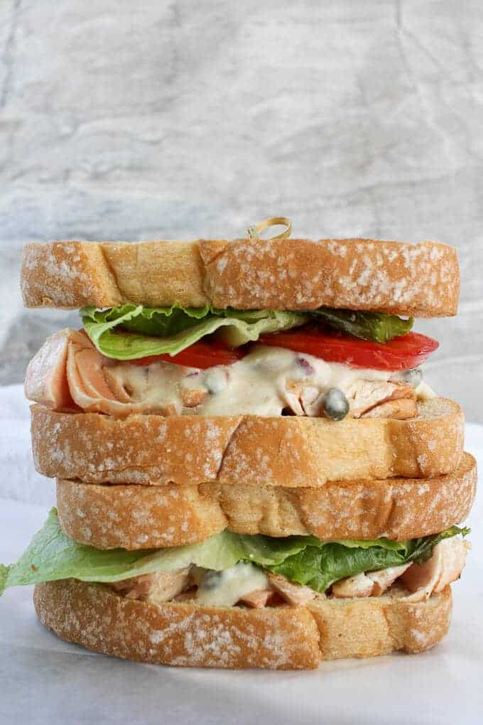 Two Easy Salmon Sandwiches with Dijon Sauce, stacked on top of one another.