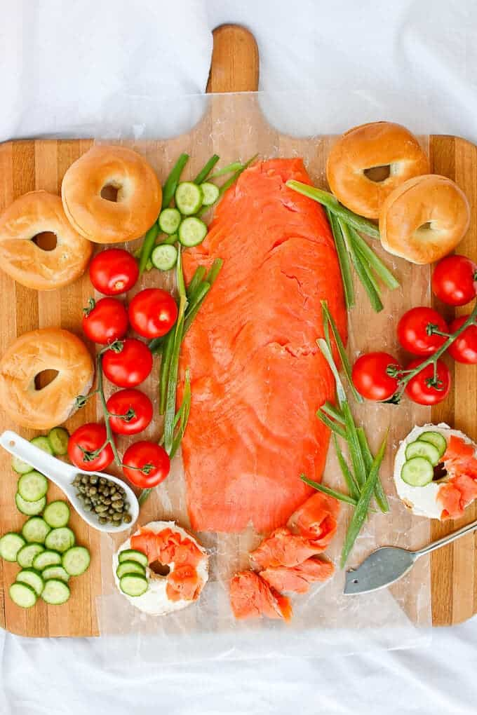 Bagels and Lox arranged on a Serving Platter with Tomatoes, Cucumbers, Capers, and Cream Cheese
