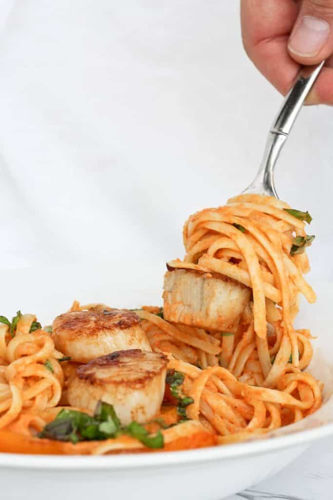 Twirling Pasta and a Scallop onto a Fork