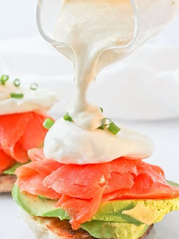 This Smoked Salmon Eggs Benedict is an Easy and Healthy Brunch Recipe. It's made with smoked salmon, poached eggs, and a creamy yogurt sauce, and is a lighter take on the breakfast classic!