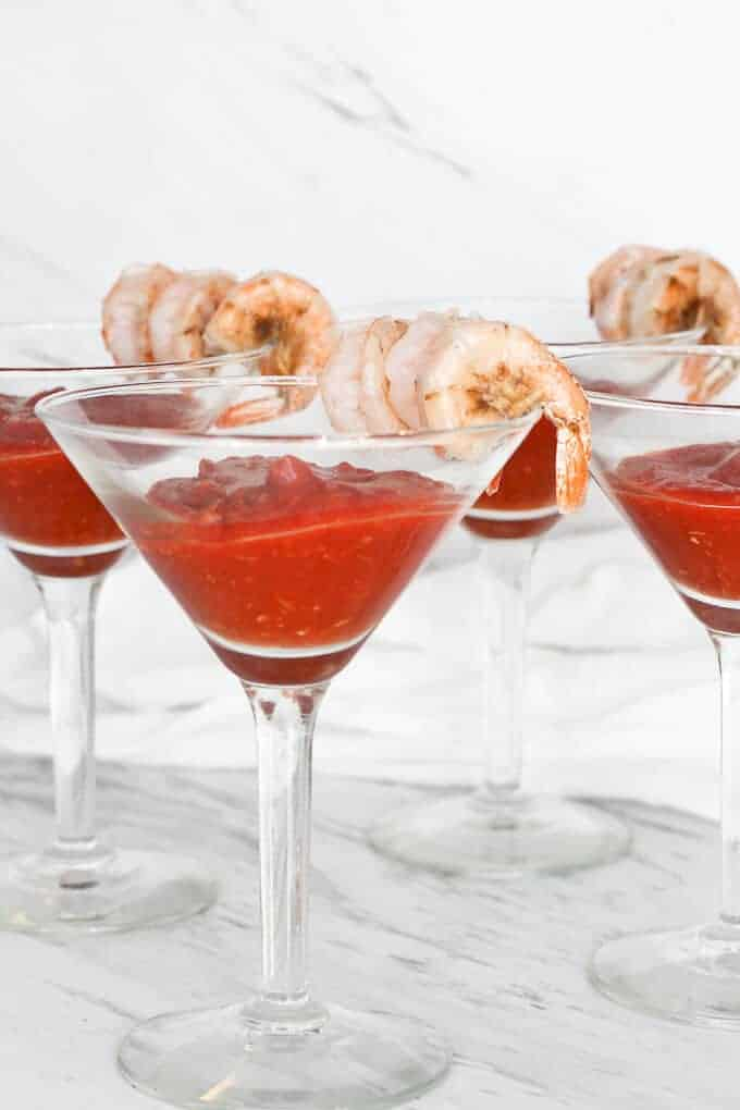 Shrimp Cocktail Served in Cocktail Glasses with the Sauce in the Glass and the Shrimp on the Glass Rim.