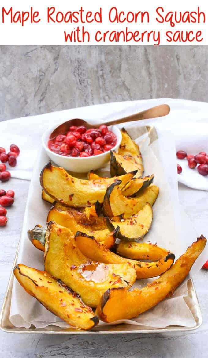 This vegan-friendly Maple Syrup Roasted Acorn Squash with Cranberry Sauce is an easy side dish that only requires a few minutes of hands-on work, and is perfect for fall!#Maple #AcornSquash #CranberrySauce #Vegan