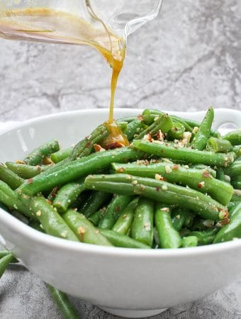 This Green Bean Salad with Almonds is made with fresh green beans, almonds, and an quick homemade honey mustard dressing.  Serve it warm or cold for an easy side dish!