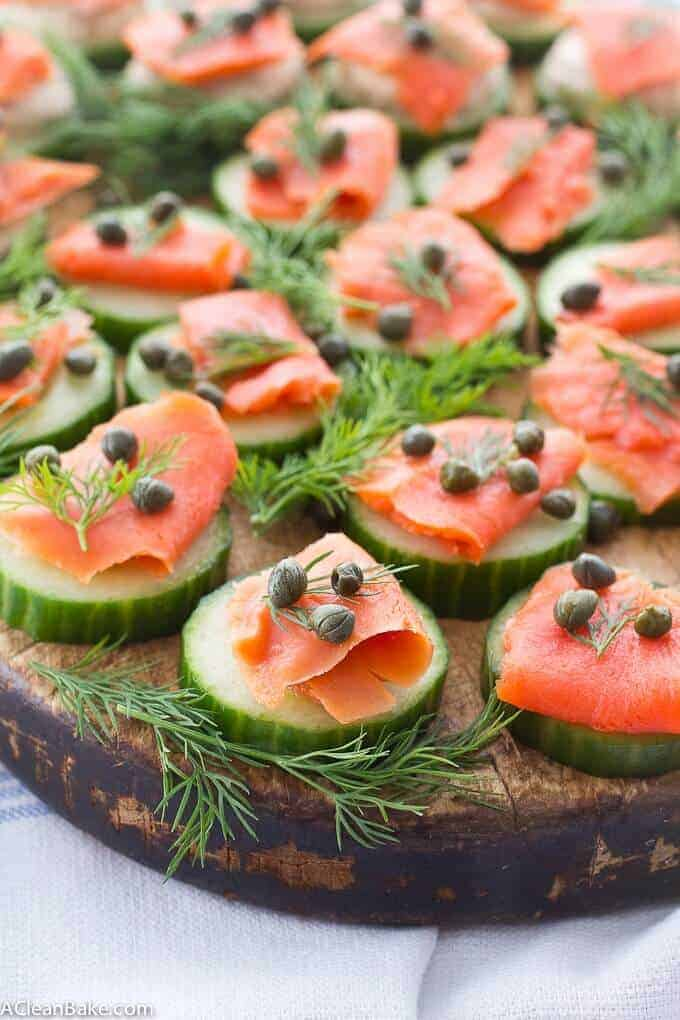{Cold-Smoked} Salmon Cucumber Bites on a wooden tray- from A Clean Bake