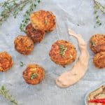 Sardine Fish Cakes in a stack with sauce on the serving tray