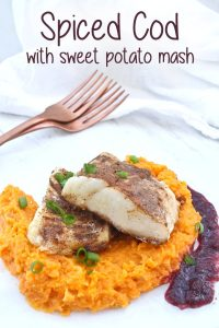 This spiced fish recipe features pan-roasted cod coated with garam masala, along with an easy sweet potato mash and a puréed raisin and wine sauce.