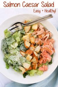 This Salmon Caesar Salad is a healthy and delicious take on a classic Caesar.  It features easy, homemade dressing, freshly baked croutons, and pan-seared salmon.