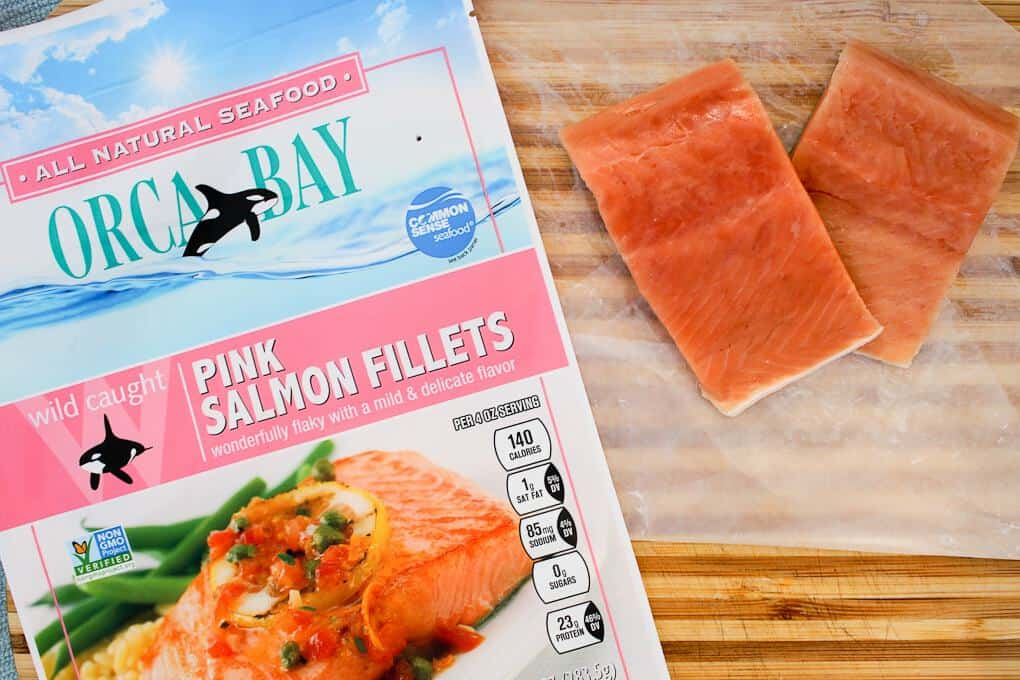 Orca Bay Pink Salmon fillets next to the packaging
