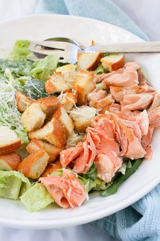 Salmon Caesar Salad in a serving bowl