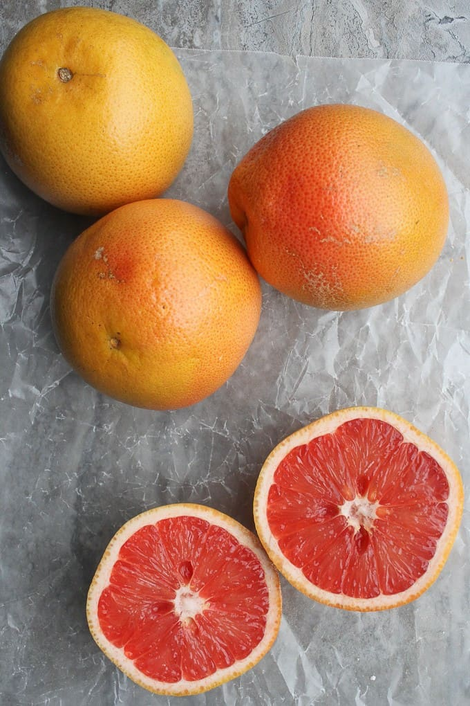 Ruby Red Grapefruit on a counter, one cut in half