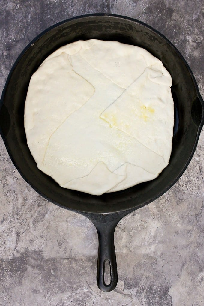 Fold the edges of the dough over