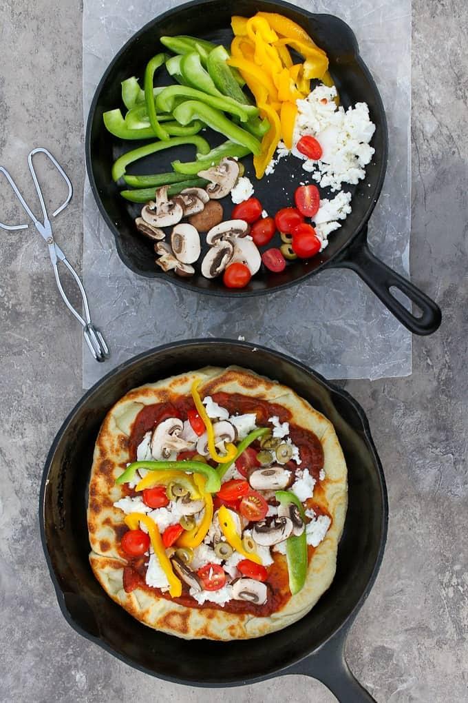 Add tomato sauce, cheese, + veggies