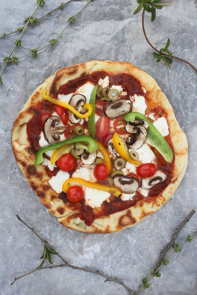 Campfire pizza loaded with veggies