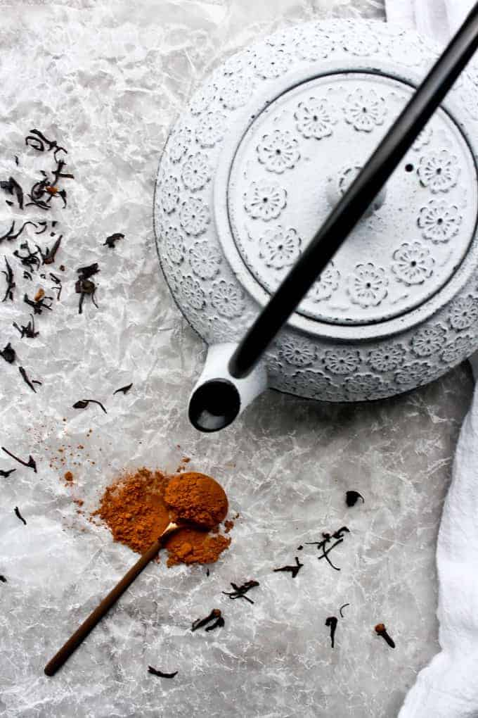 teapot with cocoa powder and loose chai tea