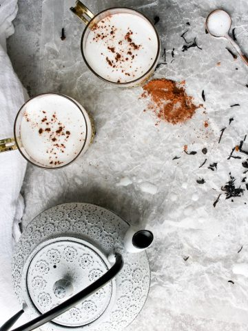 chai tea latte with chocolate in teacups with a teapot