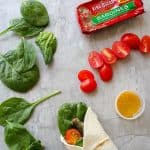 These quick fish wraps with sardines are an easy, healthy lunch on the go! They're perfect as a packed lunch for work, + are ideal for road trips and camping.