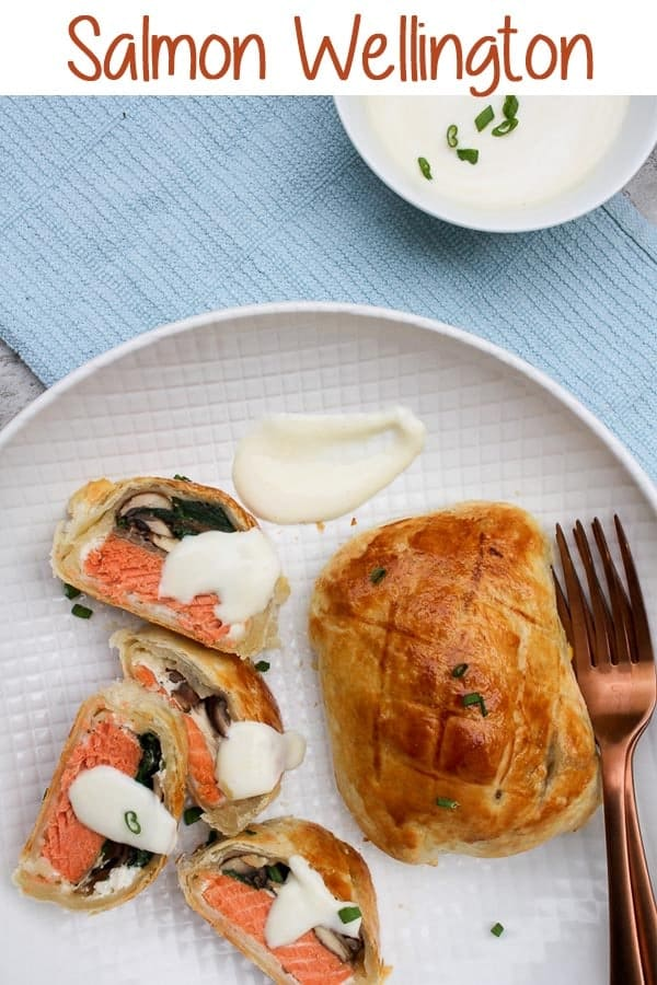 This Salmon Wellington recipe features individually portioned puff pastry packets filled with spring greens, mushrooms, goat cheese, and salmon, along with an easy mustard sauce.