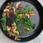 Sauté mushrooms + greens