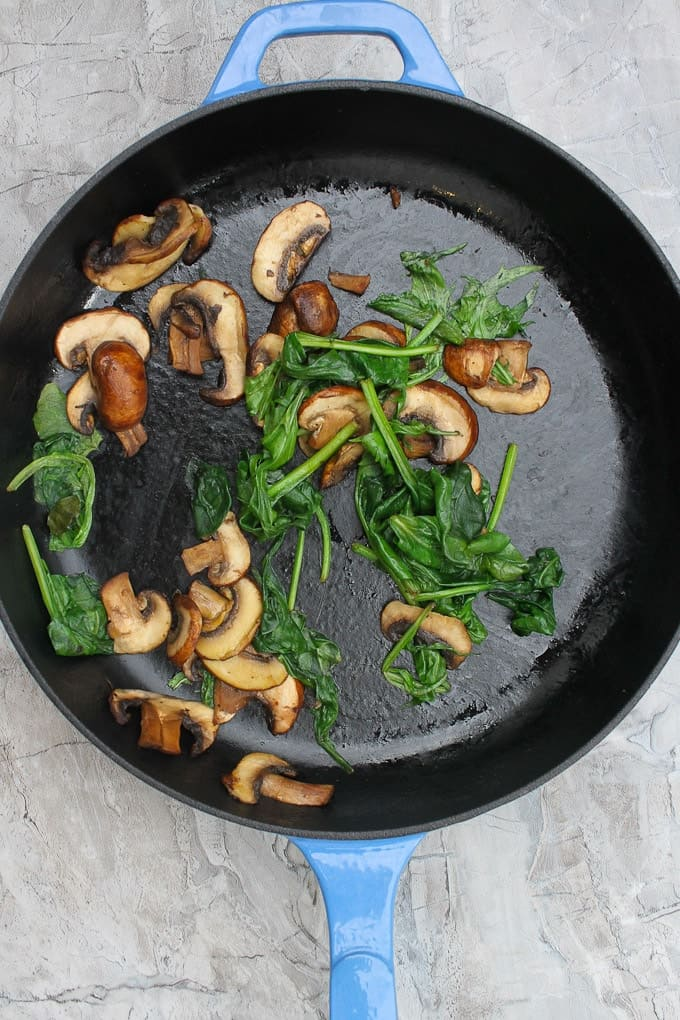 Sauté mushrooms + greens