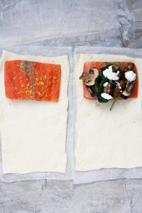 Cut pastry + place salmon on the edge with toppings