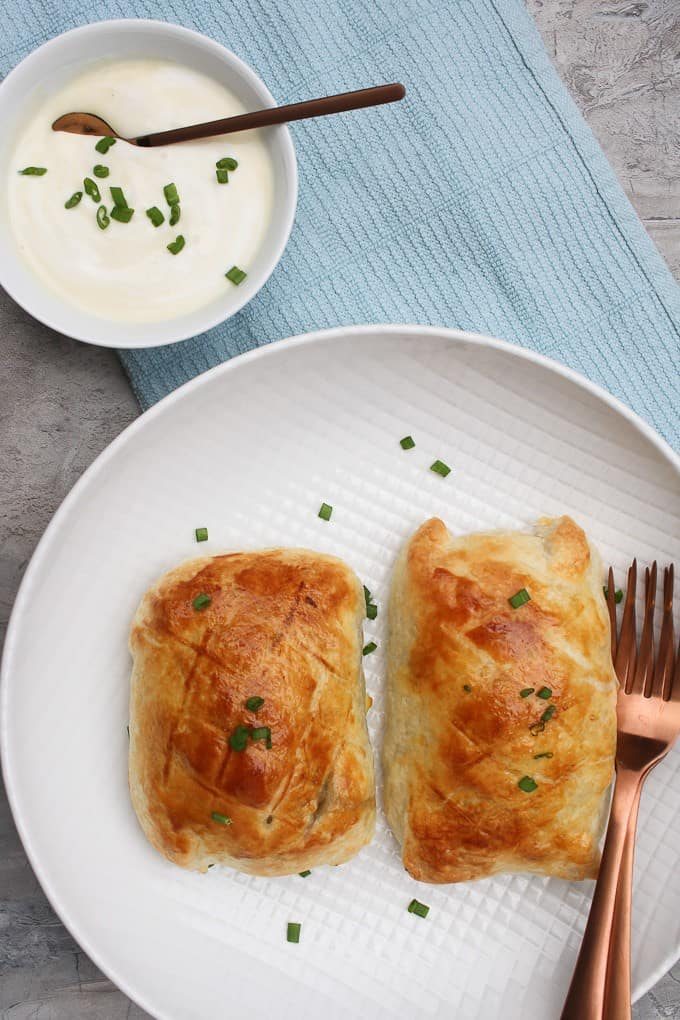 Salmon wellington on serving plate with yogurt sauce
