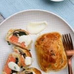 Salmon Wellington and yogurt sauce on a serving platter