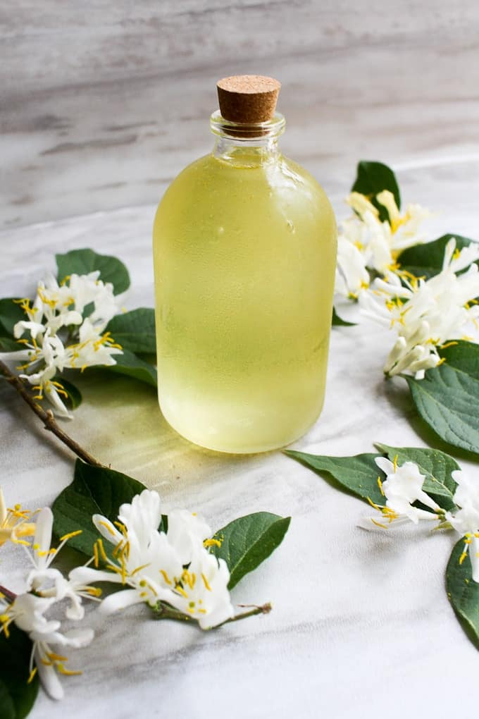 honeysuckle simple syrup in a bottle
