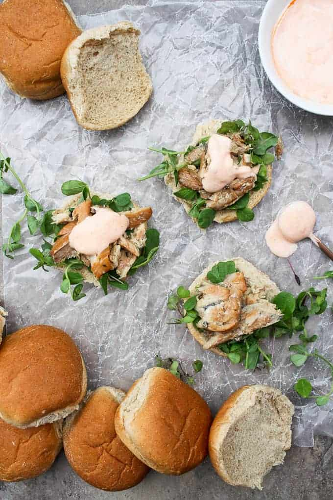 Smoked fish sandwiches being put together on a countertop