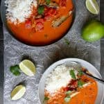 camping dinner: goan fish curry in bowls with lime wedges and cilantro